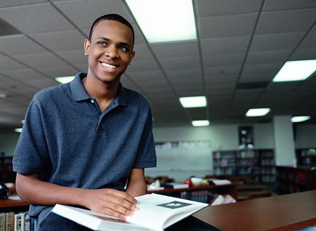 Smiling man in library